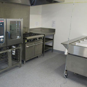 Epping Memorial Hall Kitchen includes a 6-burner hotplate and oven, large stainless steel bench space and equipment available for use.