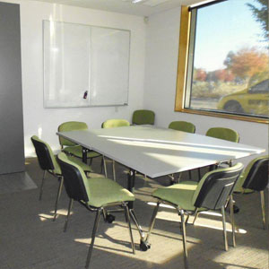 Meeting Room 1 has a capacity to fit up to 12 people. It can be used for meetings or consulting rooms. The room also has great natural light.